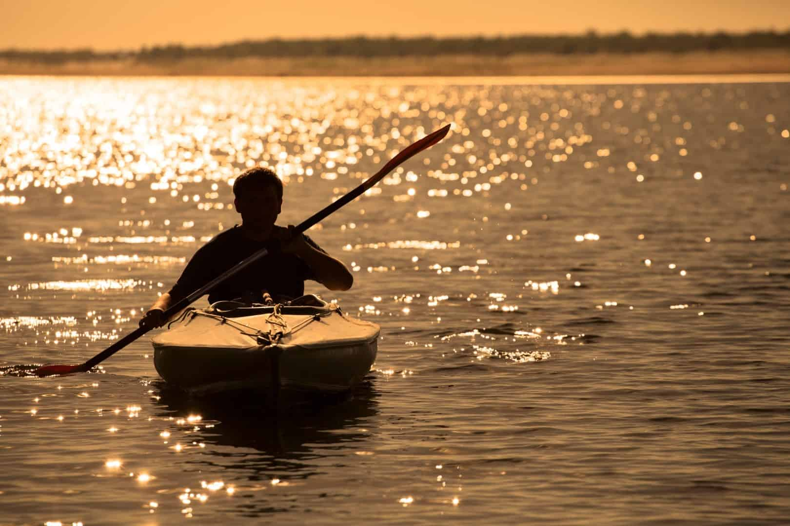 Kayaking for exercise at sunset