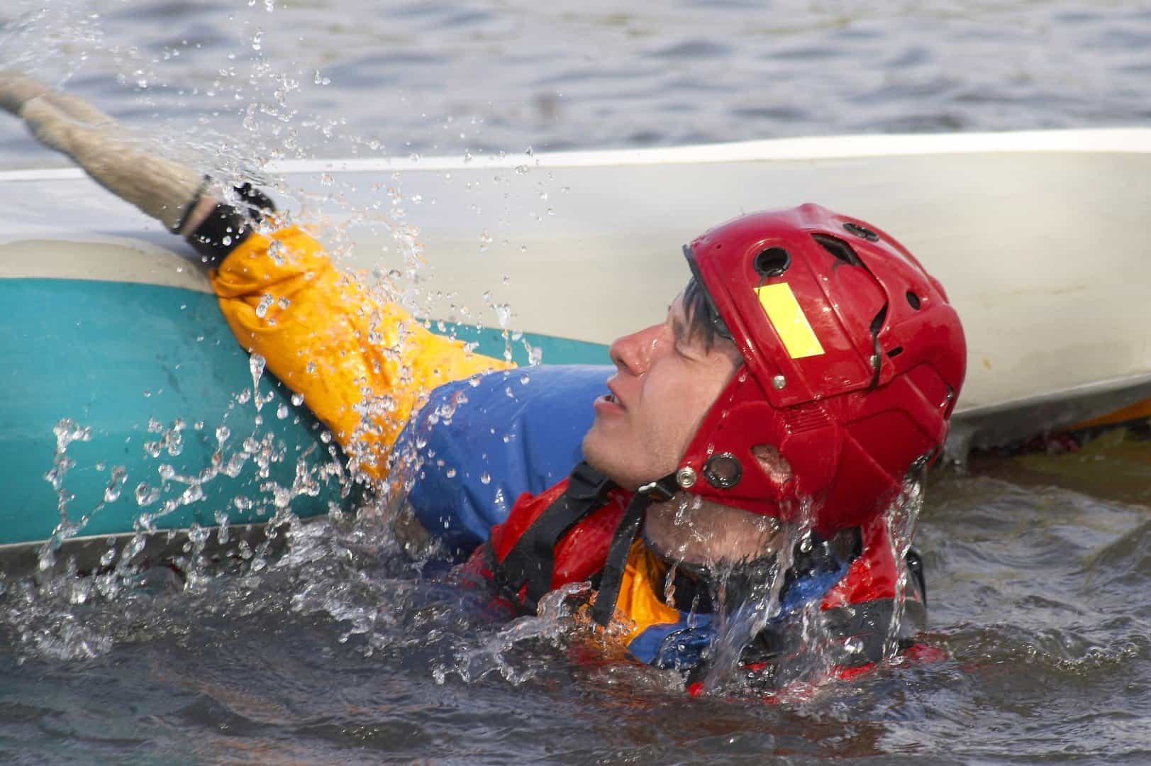 Falling and entering a kayak from the water