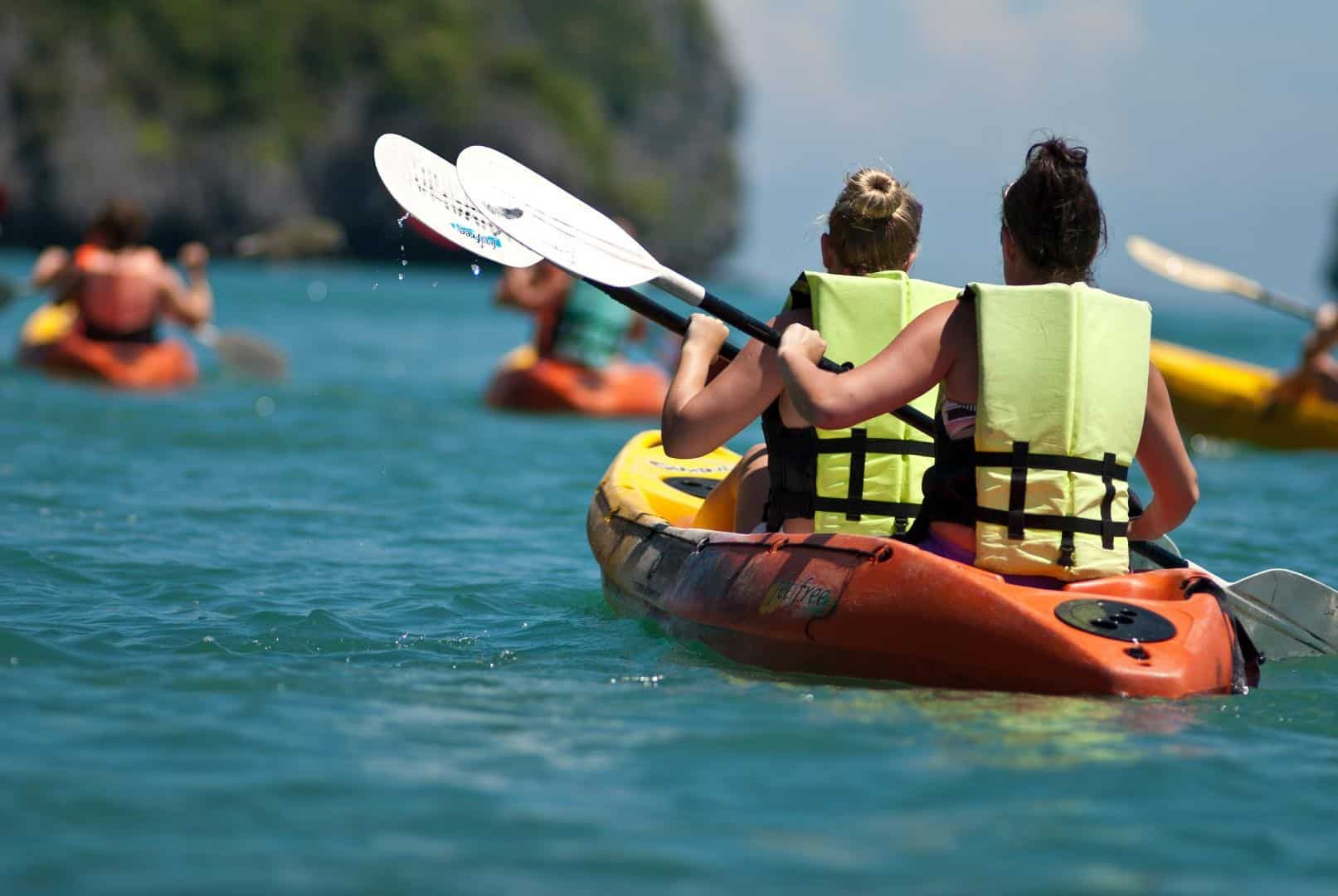 Traveler kayaking in the thai ocean