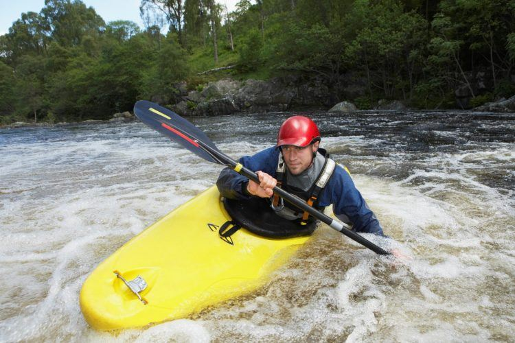 Whitewater Kayaker in Rapids