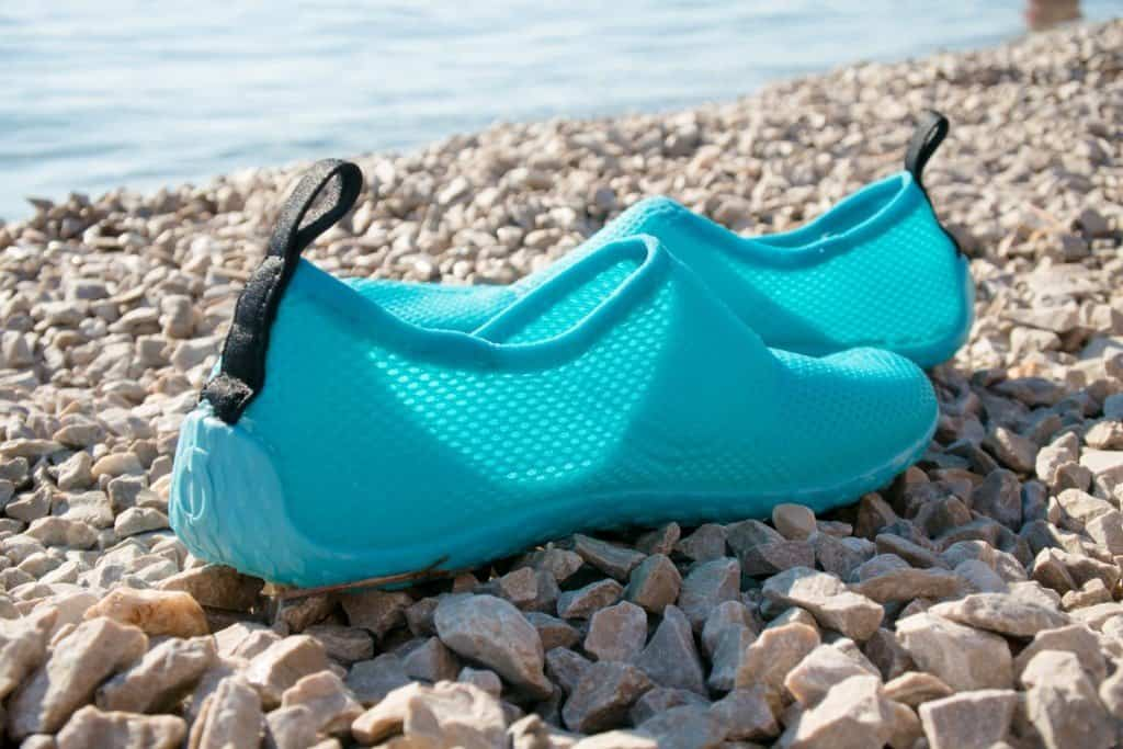 Water shoes on a rocky beach