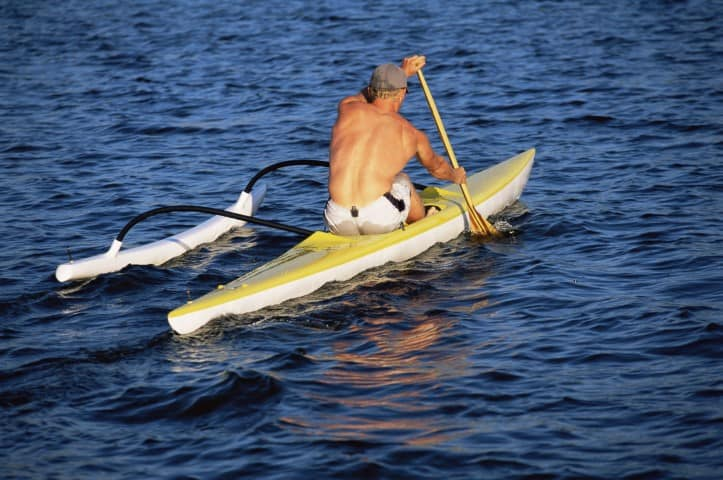 Kayak with outrigger stabilizer